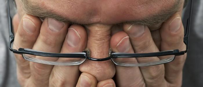 600-00917146 © Masterfile Model Release Man Rubbing Eyes